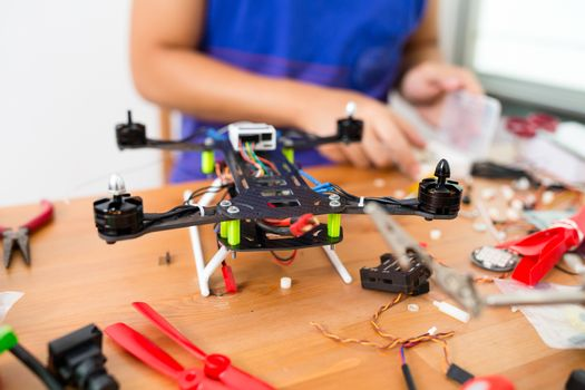 Man install the flying drone