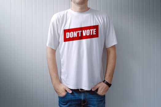 Handsome man wearing shirt with Don't vote title