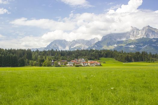 a beautiful view of the austrian alps and Oberndorf in Tirol, Austria