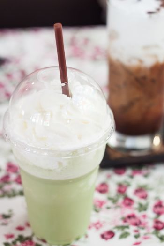 Macha green tea with whipped cream, stock photo