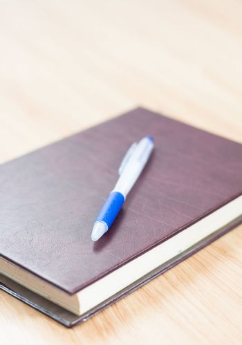 Classic leather notebook with pen, stock photo