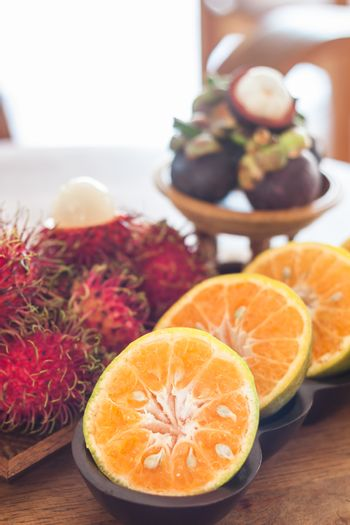 Thai tropical fruit on wooden table, stock photo