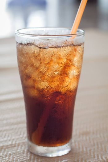A glass of cola with ice, stock photo