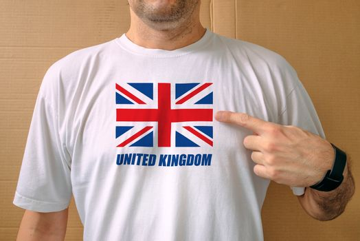 Handsome man proudly wearing white shirt with United Kingdom fla