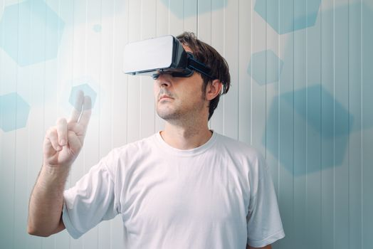 Man with VR goggles working in virtual reality environment
