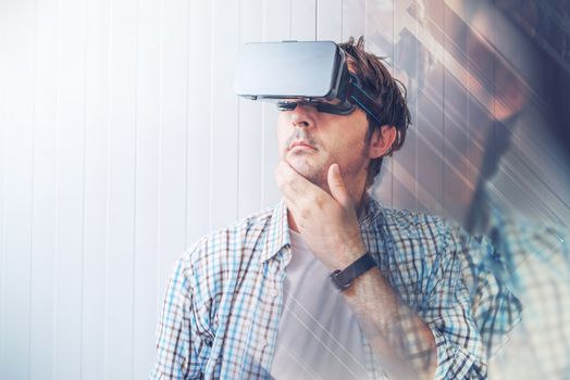 Man with VR goggles exploring virtual reality content