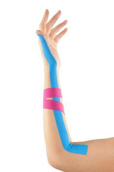 Kinesio tape on female hand isolated on white background. Chronic pain, alternative medicine. Rehabilitation and physiotherapy.
