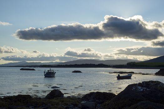boats in a quiet bay near kenmare on the wild atlantic way ireland