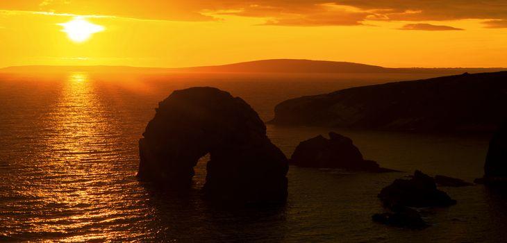 beautiful sunset over the virgin rock and ballybunion coast on the wild atlantic way