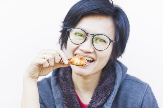 Asian woman eating delicious chicken, stock photo