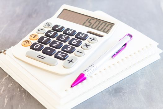 Calculator, pen and notepad for notes