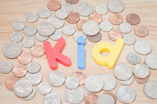 Kid alphabet with various US coins