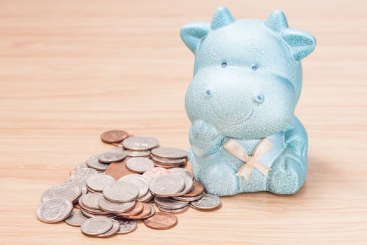 Green cow doll saving box with coins