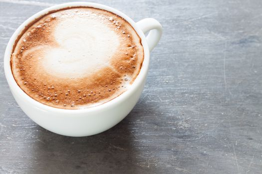Coffee cup on grey background