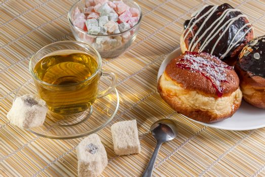 Green tea, fresh cherry muffin, colorful delight and doughnut, sweet dessert, close up