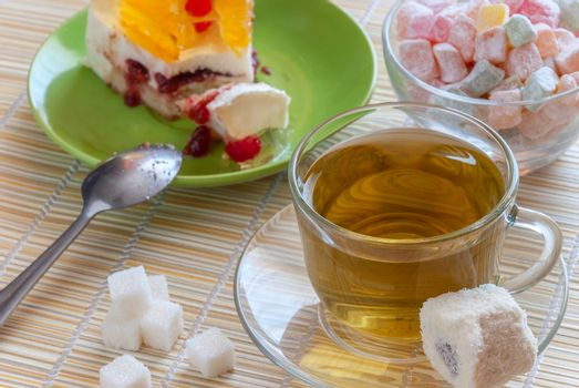 Green tea, colorful delight and cake, sweet dessert, close-up