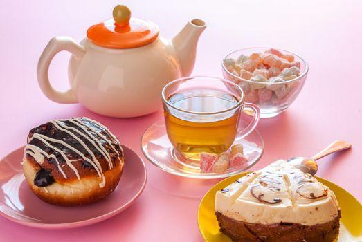 Tea, fresh cherry muffin, colorful delight, cake and doughnut, various sweet dessert