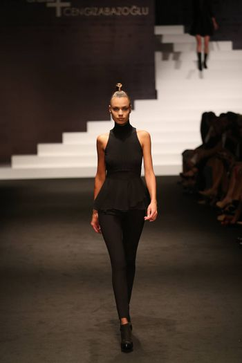 ISTANBUL, TURKEY - SEPTEMBER 30, 2015: A model showcases one of the latest creations in ADL Cengiz Abazoglu Catwalk