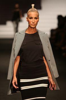 ISTANBUL, TURKEY - SEPTEMBER 30, 2015: Model Cagla Sikel showcases one of the latest creations in ADL Cengiz Abazoglu Catwalk
