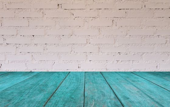 Blue wooden table top with brick wall