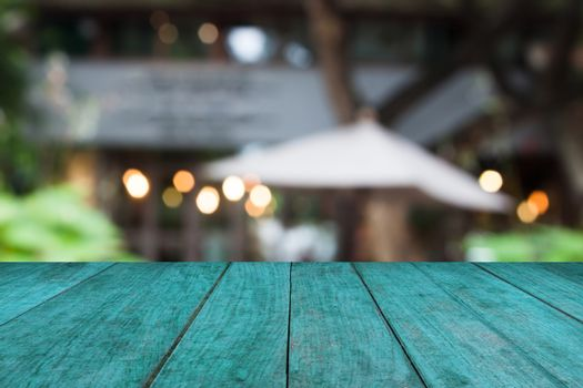 Blue wooden table top with cafe background