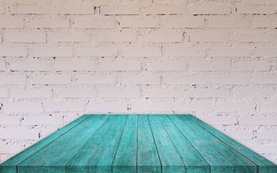 Perspective blue wooden table top with brick wall