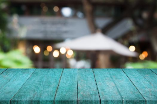 Perspective blue wooden table top with cafe background