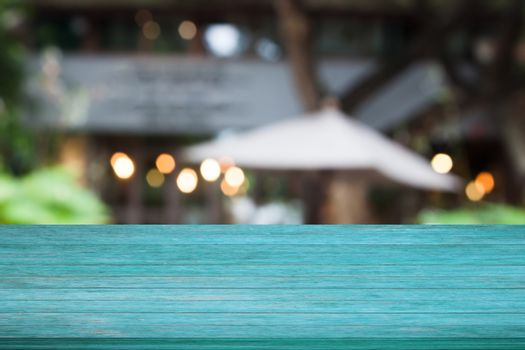 Top of blue wooden table with cafe background