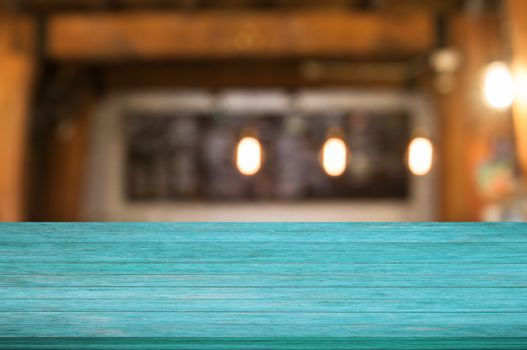 Top of blue wooden table with coffee shop