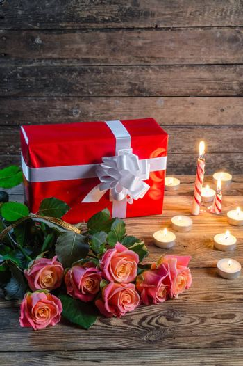 Roses and gift box, rustic style
