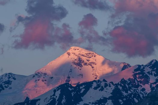 Big mountains in clouds on sunset