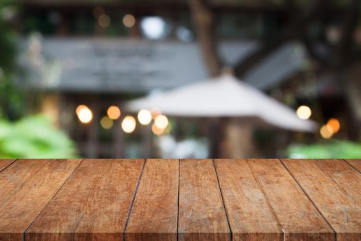 Perspective brown wooden table top with cafe background