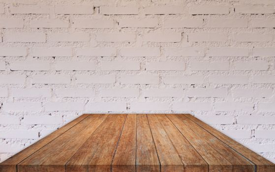 Perspective wooden table top with brick wall