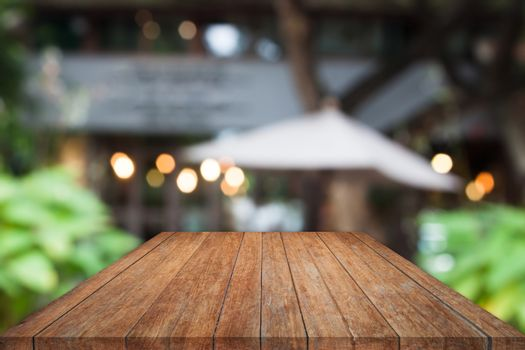 Perspective wooden table top with cafe background