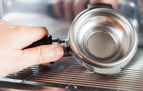 Empty coffee basket with coffee machine