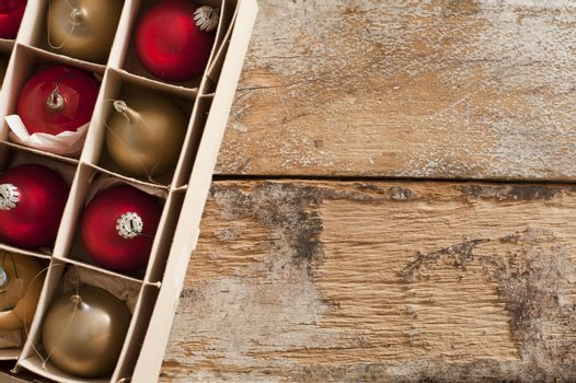 Box of packaged gold and red Xmas ornaments