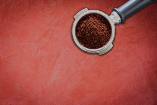 Coffee grind in group on red concrete background