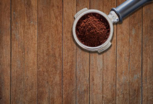 Coffee grind in group on wooden background