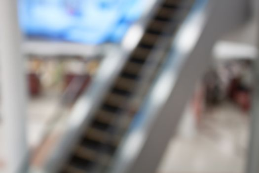 Abstract blurred background of escalator in Airport, shallow depth of focus