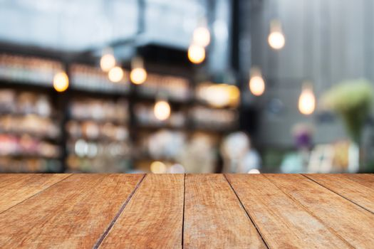 Perspective wood and blurred cafe background. product display template