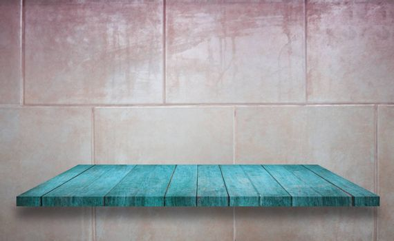 Top of blue wooden shelf on ceramic tiles wall texture background, stock photo