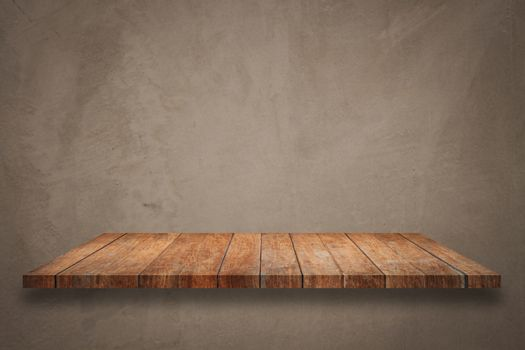Top of wooden shelf on concrete background. For product display