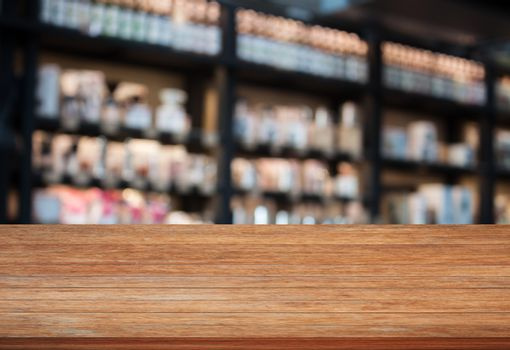Top wooden table in coffee shop blurred background with bokeh