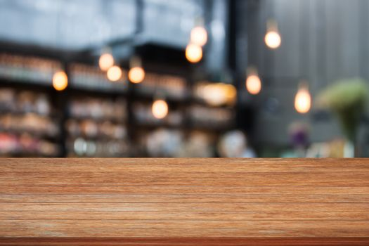 Top wooden table with cafe background, stock photo