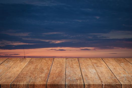 Perspective top wooden with sunrise beautiful sky, stock photo