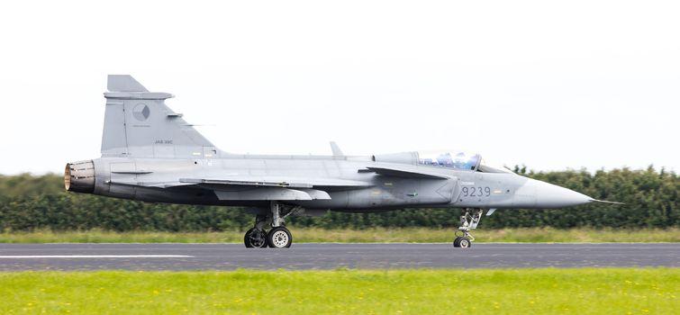 LEEUWARDEN, THE NETHERLANDS-JUNE 10: Modern tactical fighter jet JAS-39 Gripen performs at the Dutch Airshow on June 10, 2016 at Leeuwarden Airfield, The Netherlands.