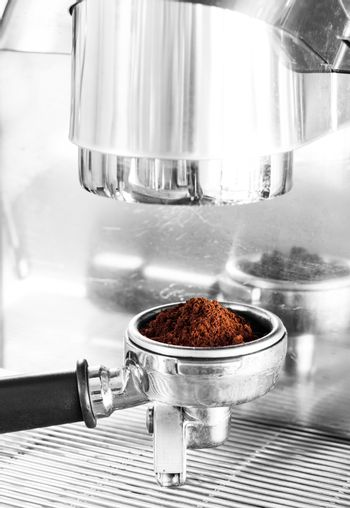 Coffee grind in group with black and white filter