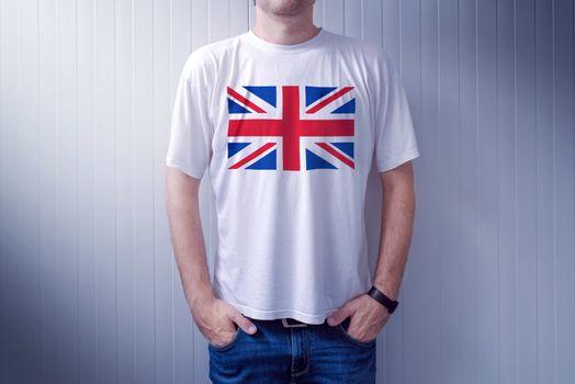 Man wearing white shirt with UK flag print