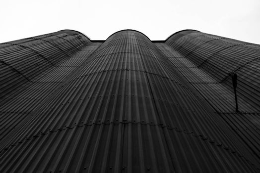 An old corrugated iron wall reaching towards the sky.