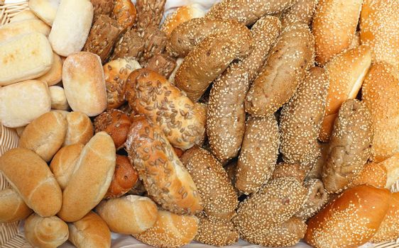 Basket of Various Bread Buns Rolls With Seeds